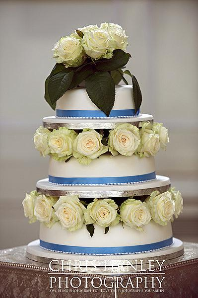 Wedding cake - simply lovely in blue and white with palest cream roses