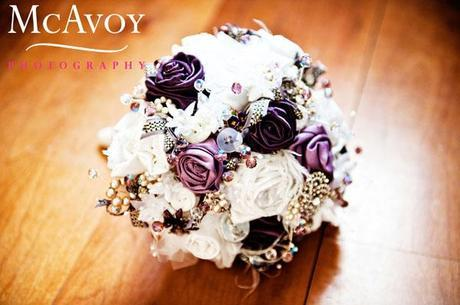The bridal bouquet made of ribbon roses, buttons, jewels and beads