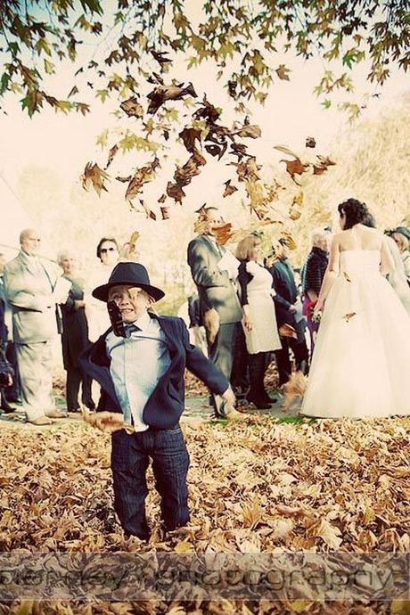 I love this photo! The coolest guest at the wedding lets his hair down and kicks a few leaves...