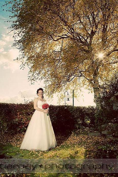 Gorgeous portrait photo of bride Emma - I love the sunlight peeking between the leaves