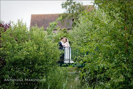 A quiet moment for the bride and groom in the gardens