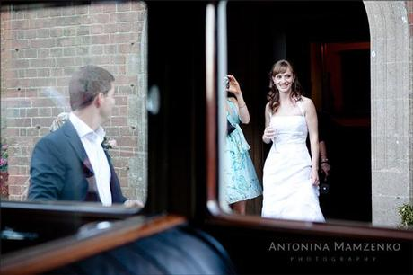 Gemma and Rob with the wedding car