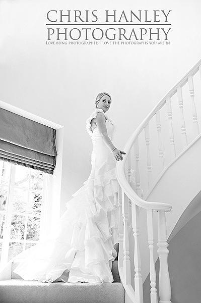 The bride: Amy is so very, very beautiful. I love the stairway with light above and behind her - and the wedding dress looks out of this world.