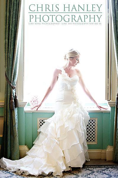 I adore this photograph of Amy on her wedding day: bathed in sunlight, so very elegant and with that wonderful dress - fit for a princess
