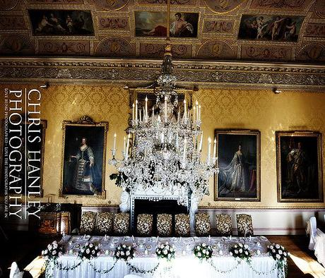 The top table and magnificent chandelier; ancestral portraits watch over the celebrations