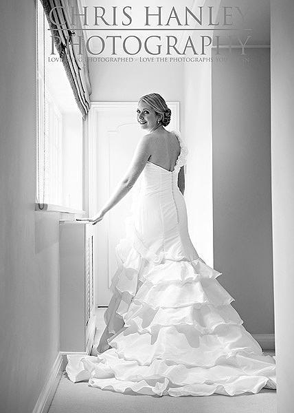 Amy's smile lights up this photograph while the soft natural sunlight brings the very best from the ruffles in her lovely wedding dress