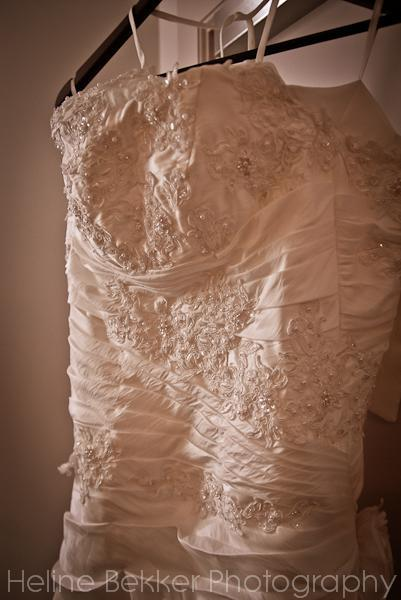 ... and the wedding dress, covered in flower patterns, pearls and twinkling crystals