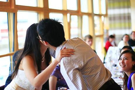 Male guest kissing the bride...