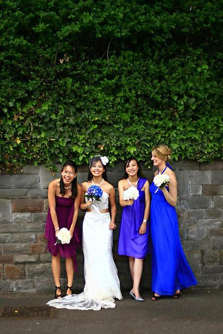 Viv and her bridesmaids in shades of purple