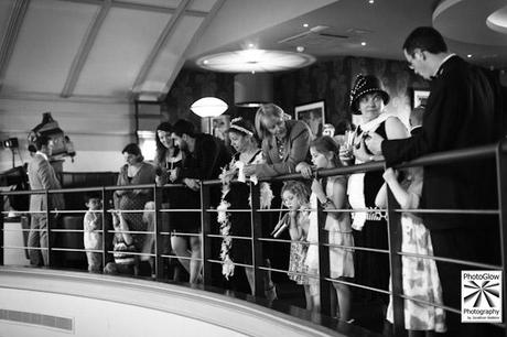Wedding guests on the balcony at The Daffodil, Cheltenham