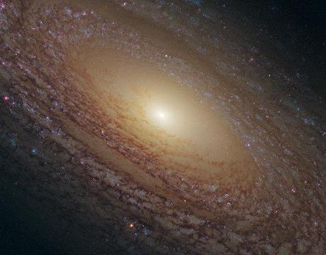 Spiral Galaxy's Glowing Newborn Stars