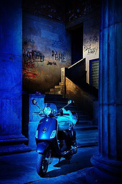 Vespa in urban setting by Chris Hanley Photography