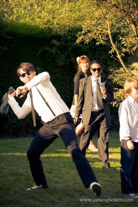Guests look on nervously as Andy takes aim