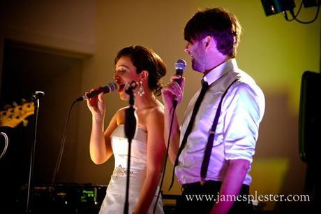 Emma and Andy sing together at the wedding reception
