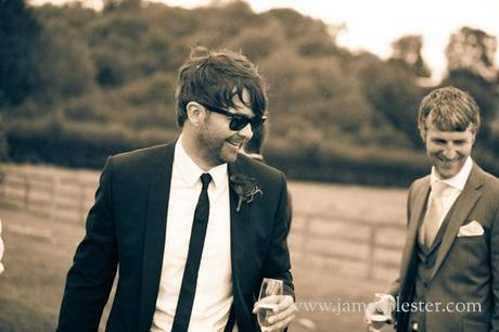 Our super cool groom enjoys some champers