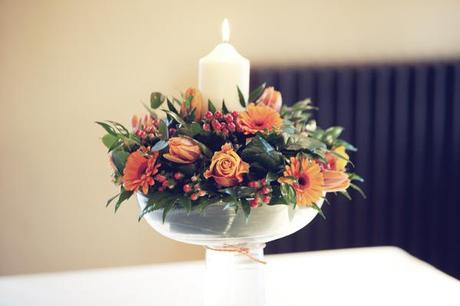 Wedding tables had centrepieces with rich, warm flowers and candles