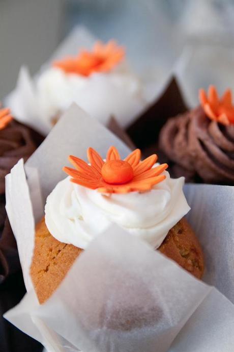 Yummy wedding cupcakes with bright orange flowers