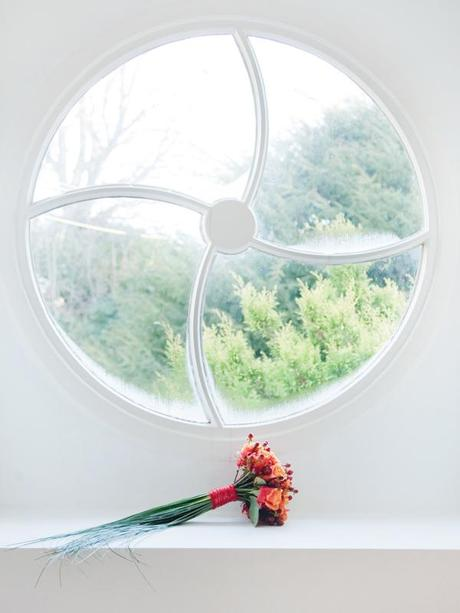 I love this shot of the bouquet by the window