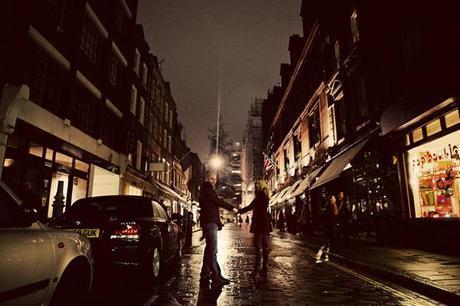 Hands held tight across a glistening London street