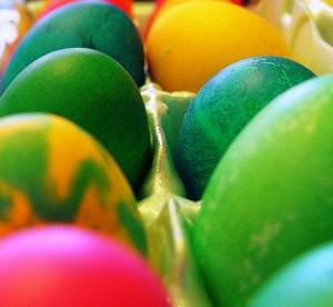 colored Easter eggs in a egg carton