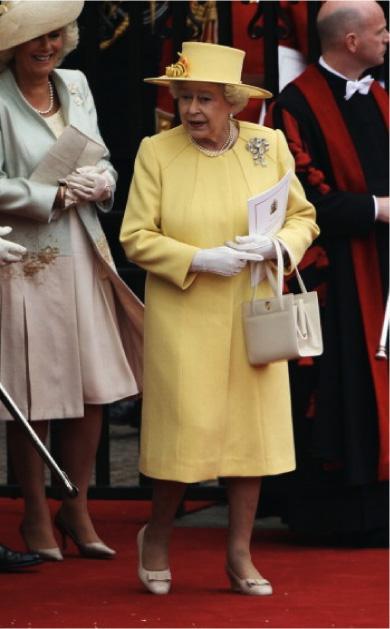 0429-9-queen-elizabeth-royal-wedding-yellow-suit_fa