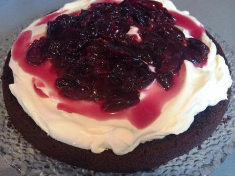 oozing cherries and cream on black forest rich chocolate cake