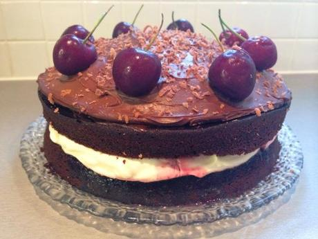 assembled recipe black forest cake fresh cherries and rich chocolate cream filled