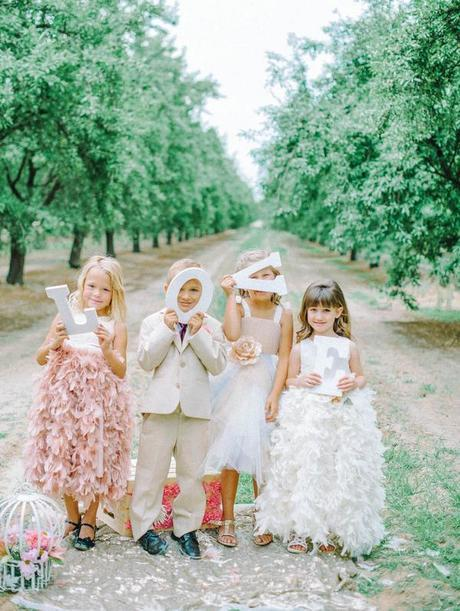 Have flower girls and ring bearer hold LOVE letters