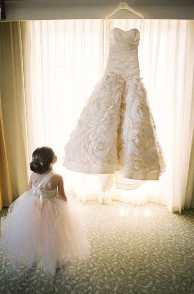 Little Girl in awe of the Wedding Dress