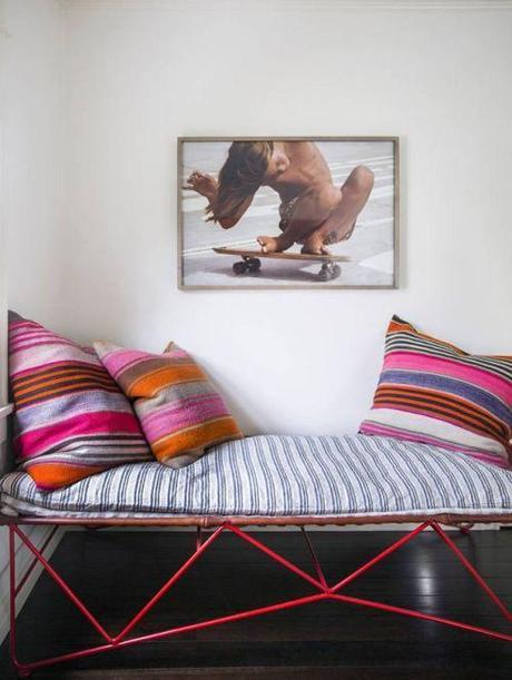 Bench WIth Kilim Pillows And Statement Photo Of Skateboarder