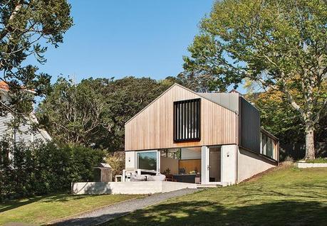Modern home with brick base and cedar rain screen on top level