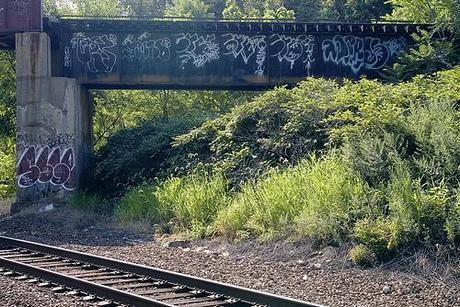 tags and throwies on a railroad bridge.jpg