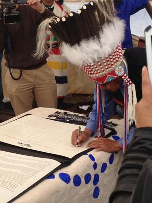 Chief Earl Old Person signs buffalo treaty