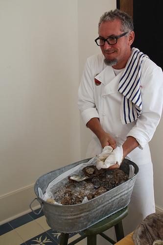 Chef Scwartz Shucking Oysters at Studio b. Alys Beach