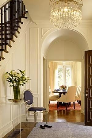 beautiful arched door in traditional foyer