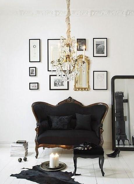 white walls black settee gold art wall gallery hide rug