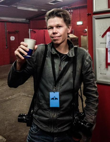Hard at work, 2 cameras (and a drink) at the ready. See you next year!