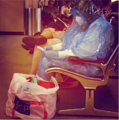woman in hazmat suit in Dulles
