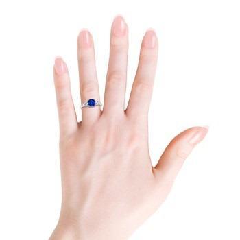 round sapphire and diamond three stone ring hand view thumb | blog.angara.com