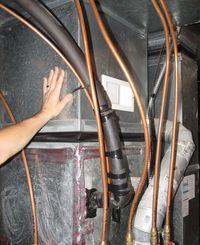 Hand on furnace plenum