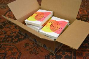 Opening the first box of paperbacks. Random House pattern echoed in my grandfather's Persian carpet.