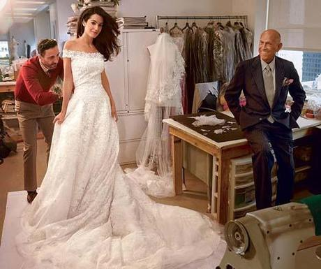 Amal Alamuddin at final fitting with designer Oscar de la Renta