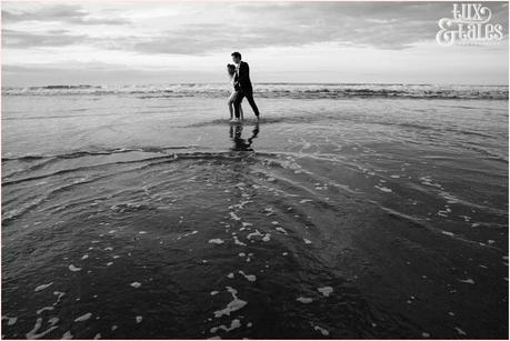 Photography Engagement Shoot in Whitby | Girl wearing Red Flower crown | Alterntive Couple whereing Vintage clothing |walking through the water