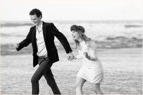 Photography Engagement Shoot in Whitby | Girl wearing Red Flower crown | Alterntive Couple whereing Vintage clothing | Laughing and running ont he beach