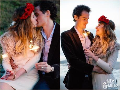 Photography Engagement Shoot in Whitby | Girl wearing Red Flower crown | Alterntive Couple whereing Vintage clothing |Kissing with sparklers