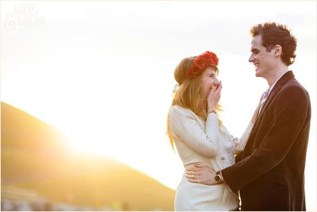 Photography Engagement Shoot in Whitby | Girl wearing Red Flower crown | Alterntive Couple whereing Vintage clothing | Laughing in the sunset
