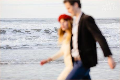 Photography Engagement Shoot in Whitby | Girl wearing Red Flower crown | Alterntive Couple whereing Vintage clothing | Water in focus