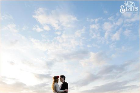 Photography Engagement Shoot in Whitby | Girl wearing Red Flower crown | Alterntive Couple whereing Vintage clothing | Couple in the clouds