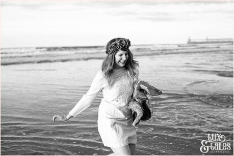 Photography Engagement Shoot in Whitby | Girl wearing Red Flower crown | Alterntive Couple whereing Vintage clothing | Running through the ocean water holding shoes