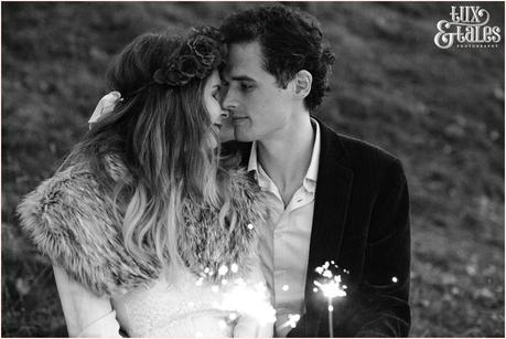 Photography Engagement Shoot in Whitby | Girl wearing Red Flower crown | Alterntive Couple whereing Vintage clothing | Kissing with sparklers